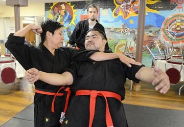 Oki Chi Taw practitioners Amy Desjarlais, left, and Alberto Gonzales spar at the Native Canadian Centre of Toronto July 14. The centre offers classes in the aboriginal martial art as part of its ongoing fitness programming.